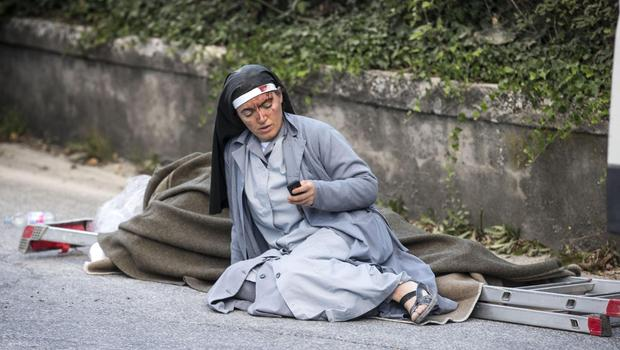 Nun in iconic Italy earthquake photo shares her story of survival